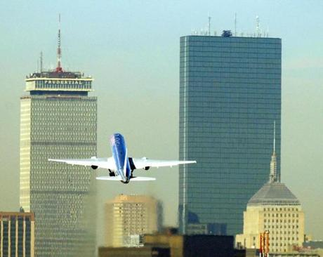 An American Airlines flight takes off from Boston's Logan Airport towards the Prudential Tower (L) and the John Hancock Tower (R) 18 September 2001 one week after two flights from Boston were involved in terrorist attacks on the World Trade Center in New York.AFP PHOTO/C.J. GUNTHER 10logan airlinegallery