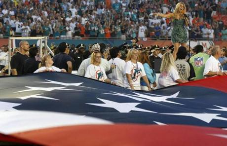 Singer Fergie, who is a Dolphins minority owner, sang the national anthem before the game.
