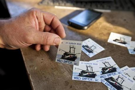Captain Steve Arnold displayed a card he uses to tag the fish his boat catches. Using the cards and bar codes, consumers are later able to trace their fish from his boat to them.