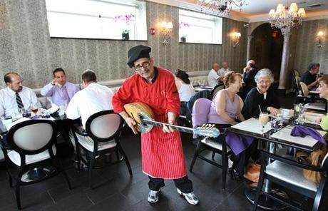 Dimitri Ourgantzidis showed off  musical abilities during the opening of Christina's , a new restaurant in Newton owned by his wife, Christina Patsios.