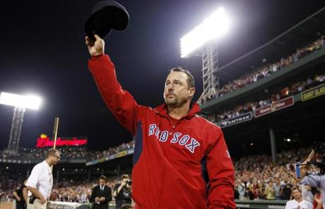 Red Sox pitcher Tim Wakefield waved to the hometown crowd cheering his 200th career win, which was against the Toronto Blue Jays at Fenway Park.