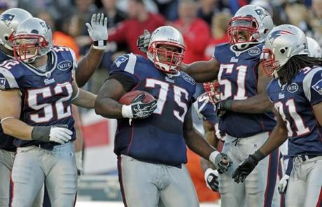 Vince Wilfork (center) and the Patriots danced to a 35-21 win against the Chargers yesterday in the home opener.