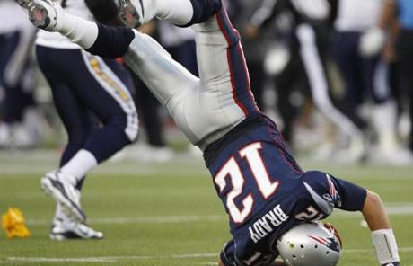 Brady was flipped on his head after being hit hard by Cam Thomas in the second half.