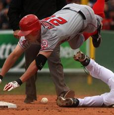 Boston, Mass- Fenway Park- Globe photo by Stan Grossfeld-May         5, 2011---Los Angeles Angels Peter Bourjos leaps over Sox Kevin         Youkilis and into second base in the 5th inning at Fenway Park.         Library Tag 05082011 Sports