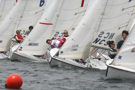 Renee Ioannilli (center, in vest) and Jana Gailunas (center,         sunglasses), of Falmouth High School, during the Figawi High         School Invitational Regatta in Nantucket Harbor, May 29, 2011.         Ioannilli --