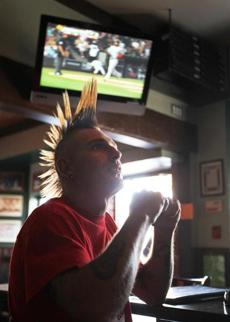 Randy Proffit, 36, enjoys setting his hair free while watching         the Red Sox at Sonny McLean's Irish Pub in Santa Monica, Calif.,         July 30, 2011 --