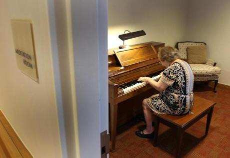 Kliman rehearsed in the meditation room on her organ, which she donated to NewBridge.