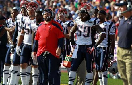 The Patriots sideline was dour as the Bills prepared to kick their game-winning field goal.