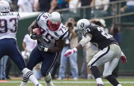 Vince Wilfork intercepted a Jason Campbell pass in the second half to thwart a promising Raiders drive.
