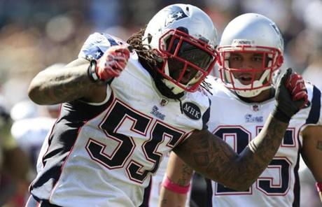 Brandon Spikes, left, and the Patriots defense surrendered 504 yards of total offense, but came up with key stops to help power the win.