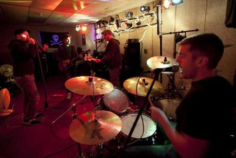 John Drake on drums, Aaron Trites on vocals, Nick Chester on guitar, and Eric Pope on bass.