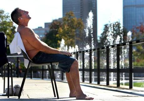 Boston100811 - Stephen Pezzone from West Roxbury enjoys the sunshine on the Rose Kennedy Greenway in the North End where the sun was warm and the fountain waters were shooting up. Boston Globe staff photo by John Tlumacki (metro)