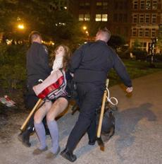 10/10/11 Boston, MA An Occupy Boston protester is dragged away and arrested by the Boston Police in the park adjacent to Dewey Square at Rose Fitzgerald Kennedy Parkway on Atlantic Street and Congress Street on Monday October 10, 2011. (Matthew J. Lee) slug: 11march section: metro reporter: John Guilfoil