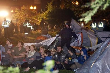 Boston Police broke down the tent city as Occupy Boston protesters continued their protest.
