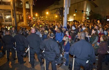 Boston Police officers formed a human wall around the park after arresting about 100 Occupy Boston protesters.
