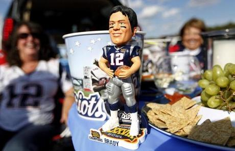Tom Brady — or at least his bobblehead doll — spent time with fans before the game.