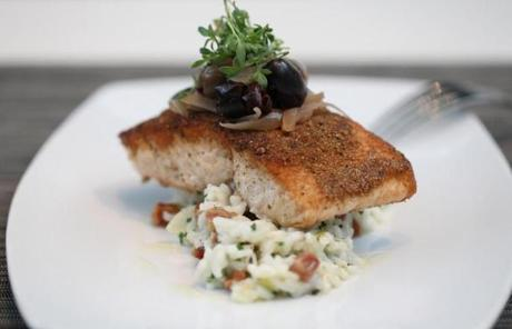 Boston 10/14/2011 Museum of Fine Arts dining New American Cafe selection Atlantic Salmon,Parmesan and leek risotto,Kalamata olives pancetta,pickled shallots. Boston Globe Staff / Photographer Jonathan WiggsSection:Living :Reporter:Slug: