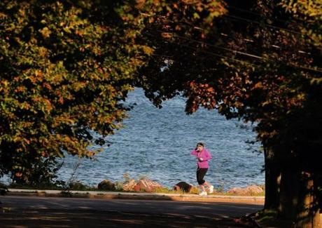 Jackie Driscoll of South Boston, jogging along Wollaston Beach         in Quincy, Oct. 5, 2011—''I was adjusting my earphones on my         Shuffle, listening to Beyoncé. It keeps me going. You know how         everybody says running clears their head? It doesn't for me.         I'malways thinking about what I'mdoing next. I deliberately         don't have my phone with me, because you listen to music on your         iPhone, your phone will still ring. You still get e-mail alerts         and text. I'ma physical therapist. This is my chance to get a         break. I like running along the water. It's better than the         gym.''