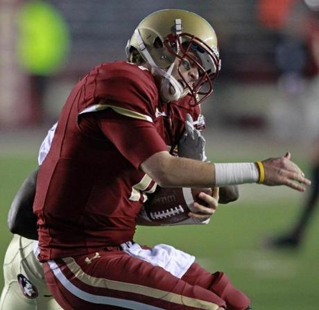 BC quarterback Chase Rettig was jarred by a Florida State defender as he tried to scramble during last night's loss.