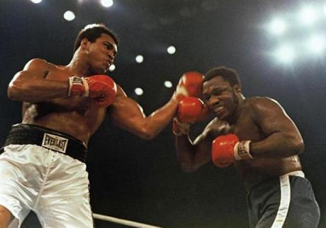 Muhammad Ali, left, and Joe Frazier fight in a 12-round non-title fight.