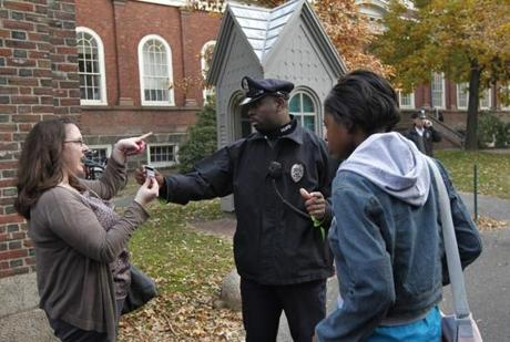 A Harvard University police officer checked IDs at the entrance to Harvard Yard.