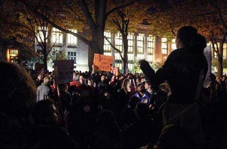 Protesters rallied on the grounds of Harvard Law School last night after being denied access to assemble in Harvard Yard.