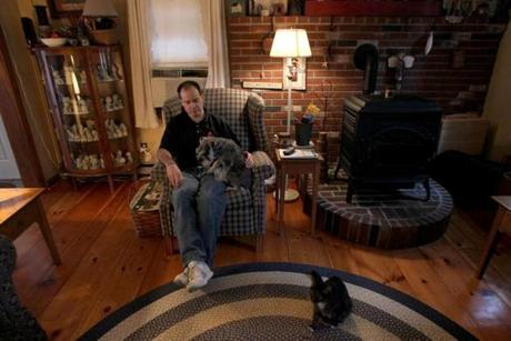 Sept. 30, 2010: Bruce Vincent sits with his dog Hans in his chair at home after work at his store.