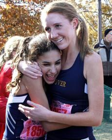 All-Scholastic Maggie Mullins, right, hugged teammate Leila Auri during a competition at Franklin Park last month.