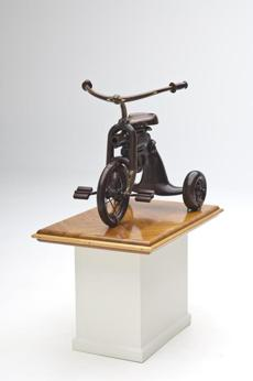 "Michael Cooper's ""Trainer Tricycle III '' has the barrel of a pistol under the seat."