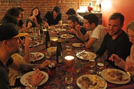 Eventually, everyone appears at Bissonnette's apartment for the potluck, where he serves bites including pate, more oysters, and dumplings. For dinner, guests munch on brined turkey, roast breasts, confit, roasted legs and wings, and gizzard sausage gravy. Each year, Bissonnette has between 12 and 35 people rotate through his house, though he says he's never hosted more than 25 at one time. While the menu changes year to year, he always serves turkey, stuffing, gravy, sauce, and cauliflower, and often pate, cheeses, oysters, and shrimp cocktail.