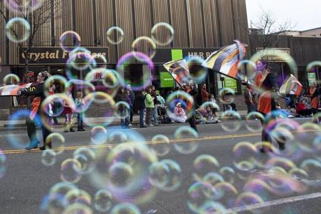 Bubbles obscured a view of the David Prouty High School Marching Panther Band of Spencer during the 59th Annual Quincy Christmas Parade in Quincy.Sunday, November 27, 2011. (Yoon S. Byun/Globe Staff)
