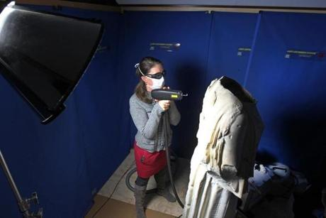 Associate curator Holly Salmon used a laser to clean a first-century sculpture at the Isabella Stewart Gardner Museum.