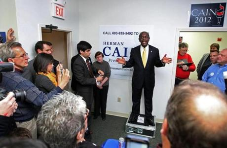 Republican presidential candidate Herman Cain spoke to supporters at his campaign office in Manchester, N.H.