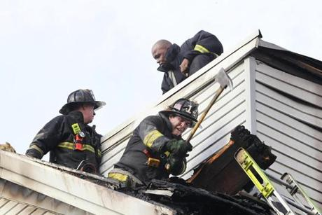 Boston, MA 12/05/11 About 60 firefighters work on the house fire at 161 Sydney Street in Dorchester, on Monday, December 5, 2011. (Pat Greenhouse/Globe Staff); Reporter: XXX; Section: Metro; Slug: 06fire