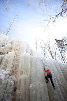 for Travel - 29icefest - A climber ascents a seventy-five foot pillar at Champney Falls. (Dominic Casserly)