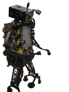The junk robot sculpture in the social area is the creation of Skunk, an Asylum renter and welding instructor.