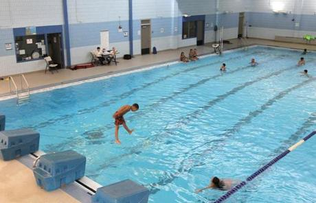 Boston, MA 11/22/11 A class enjoys the indoor pool. Jeichael K. Henderson (cq), principal of the John P. Holland School, gives The Boston Globe a tour, on Tuesday, November 22, 2011. The Dorchester school has a number of facility perks and is making changes to improve its academic programs. (Pat Greenhouse/Globe Staff); Reporter: Vaznis; Section: Metro; Slug: XXX