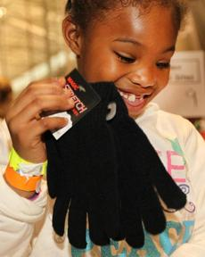 A girl opened a gift at the 2011 event.