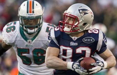12/24/2011 Foxborough, MA New England Patriots Wes Welker hauls in a 22 yard reception beating Miami Dolphins Kevin Burnett during 4th quarter action at Gillette Stadium on Sunday December 24, 2011. (Matthew J. Lee/Globe staff) slug: 25patriots section: sports Reporter: