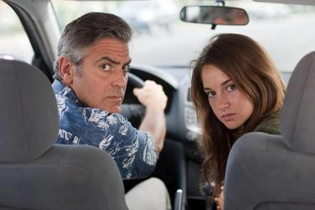 "In this image released by Fox Searchlight Films, George Clooney, left, and Shailene Woodley are shown in a scene from ""The Descendants."" (AP Photo/Fox Searchlight Films, Merie Wallace)"