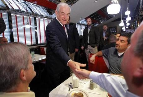 Ron Paul, shaking hands at Joey's Diner in Amherst, does better with independents in NewHampshire than with registered Republicans.