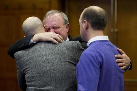 David Prior hugged sons Mark (left) and John after the guilty plea.
