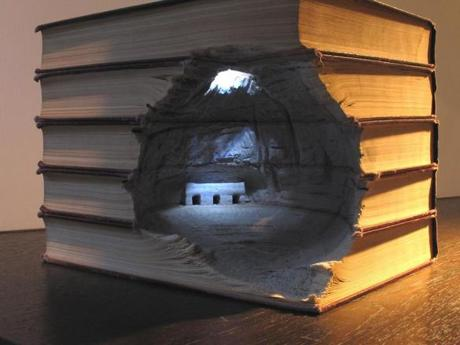 Artist and photographer Guy Laramee carves beautiful landscapes out of books.