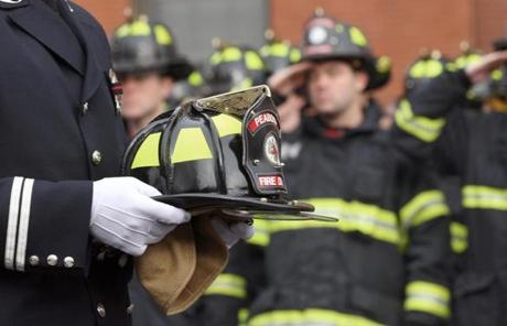 BOSTON, MA 12/ 30/ 2011:Capt. Jay Dowling from Peabody Engine 7 carries the helmit for Peabody Firefighter funeral for James Michael Rice in Peabody at St John the Baptist Church. ( David L Ryan / Globe Staff Photo ) SECTION: METRO TOPIC : 31peabody REPORTER