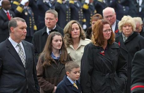 BOSTON, MA 12/ 30/ 2011:Family of James Michael Rice enter the church behind casket. Peabody Firefighters funeral for James Michael Rice in Peabody at St John the Baptist Church. ( David L Ryan / Globe Staff Photo ) SECTION: METRO TOPIC : 31peabody REPORTER
