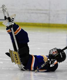 "Bryce LaPlante, 14, of the Springfield Sliders, finds himself         in an awkward position during a Junior Sled Hockey scrimmage at         Amelia Park Ice Arena in Westfield (LaPlante, who has cerebral         palsy, is skating on his own for the first time this season),         Dec. 5, 2011 ""I was trying to go after the puck and I fell. I'm         like a turtle because of the way I'm lying and trying to get up.         My dad wants me to try and get up on my own. One side I can do         it and the other side I can't. I tried my best but I couldn't.         It was nothing. I've been playing since I was 8. I know what I         can do. I know that I'm strong enough to get myself off the         ground. am a good player. I need to work on my focus. When I         started playing, I couldn't push myself but now in the         tournament my dad wants me to push myself. It's getting me tired         out. But now that I have him off my neck, I can focus. It feels         like I'm strong enough to push myself and get after the puck. I         like to play offense. It was funny, I scored a goal against the         Pee Wee team on Tuesday in a scrimmage. I think I'm like         Chara.''"