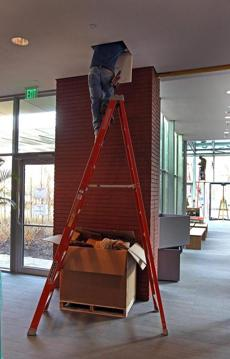 BOSTON, MA 01 / 06 / 2012: Electrician Dan Vicente (cq) working in the ceiling at The Isabella Stewart Gardner museum getting ready, the big run up to the opening of the Gardner's new building . ( David L Ryan / Globe Staff Photo ) SECTION: LIFESTYLE TOPIC : REPORTER Geof Edgers
