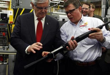 Newt Gingrich handled a Ruger rifle during a factory tour yesterday in Newport, N.H. Having dropped after a fall surge, he has a long way to go to climb back among the poll leaders.