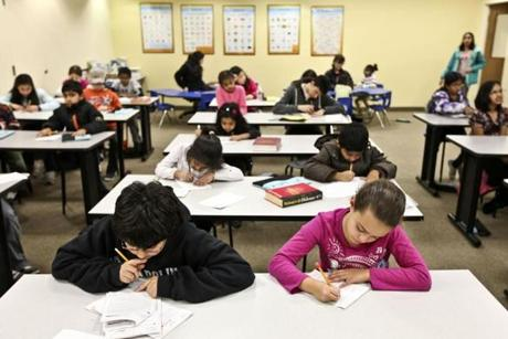 01/09/2012 FRAMINGHAM, MA Students participate in an enrichment class at Kumon of Framingham (cq). (Aram Boghosian for The Boston Globe)