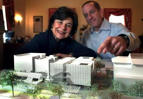 FROM MERLIN ARCHIVE DO NOT RESEND TO LIBRARY Boston- 1/19/2010- Gardner Museum's director Anne Hawley and Jim Labeck, the director of operations look over a 3d model of the Gardner museum's new wing(center). That's an existing apartment building at left. The original building (rt) sits in front of it facing the Fenway. Boston Globe staff photo by John Tlumacki (arts) 21gardner Library Tag 01212010 National/Foreign 05gardner 12gardner